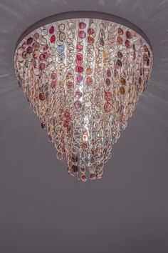 Chandelier made with plastic framed spectacles via Carpenters Workshop Gallery | Works