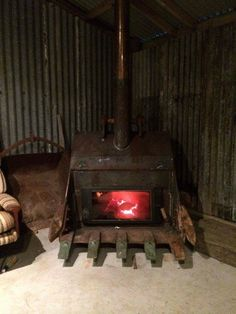 how about a bucket stove! - how about a bucket stove! Metal Projects, Welding Projects, Metal Crafts, Excavator Buckets, Stove Fireplace, Man Cave Garage, Rocket Stoves, Log Burner, Blacksmithing