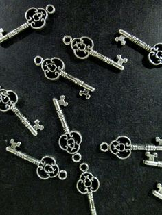 12 skeleton keys pendant charms silver plated by bunnysundries (Craft Supplies & Tools, Jewelry & Beading Supplies, Findings & Hardware, charm, pendant, lead and nickel free, skeleton key, wedding charm, wedding favor, silver key, silver key charm, silver key pendant, skeleton key charm, silver plated, antique silver key, alice in wonderland)