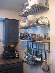 Crashing: The Tricked-Out Townhouse Kitchen organization: IKEA functional storage for lids, hanging big utensils and pans.Kitchen organization: IKEA functional storage for lids, hanging big utensils and pans. Small Kitchen Organization, Small Kitchen Storage, Diy Kitchen, Home Organization, Kitchen Decor, Kitchen Cabinets, Organizing Tips, Kitchen Ideas, Kitchen Utensils