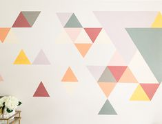 We had a difficult time determining what to do with this blank space at home. So, we teamed up with Behr to create an awesome DIY geometric wall mural! Mural Art, Wall Murals, Wall Mural Posters, Powder Room Paint, Geometric Wall Paint, Gallon Of Paint, Diy Wall Painting, Triangle Wall, Cafe Wall