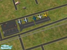 An airport for your sims!  Found in TSR Category 'Sims 2 Sets'