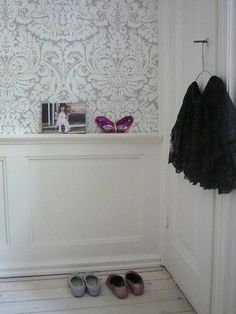 Moulding through the middle to hold picture frames..cute idea