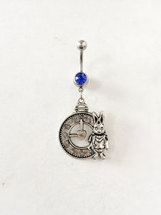 Surgical stainless steel Alice in wonderland themed belly button ring with royal blue gemstone https://www.etsy.com/uk/listing/268288400/belly-button-ring-alice-in-wonderland