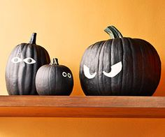 Eye Spy Pumpkins - Paint pumpkins entirely in black matte paint, let dry. Draw large eyes on the face of the pumpkin, then paint the eyeballs in one coat of white paint followed by a coat of glow-in-the-dark paint. Use black paint for the irises. Group your pumpkins together outside and watch them glow at night! (Keep them hidden in the bushes for extra spook factor!)