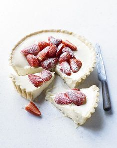 White Chocolate Strawberry Tart: Make the most of an all-time-favourite British summer fruit in this strawberry tart. Here, the fruit is encased in pastry filled with a rich and luxurious white chocolate filling.Preparation: 30 minutes, plus chilling Sweet Recipes, Yummy Recipes, Cake Recipes, Dessert Recipes, Drink Recipes, Dinner Recipes, Sweet Pie, Sweet Tarts, Just Desserts