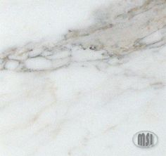 Calacatta Gold marble stone tiles by MSI Stone