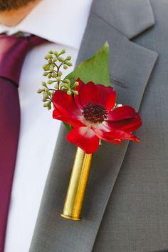 Fall Wedding Boutonniere with shell casing for the perfect touch.