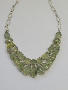 """A stunning collar featuring an array of sparkling polished faceted green-hued Prehnite gemstones, set in 925-hallmarked sterling silver. Matching bracelet available separately. Length: 16-22""""+ Adjusta"""