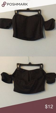 Strapless Crop Top Size L Black crop top size L. Strapless but has small sleeves that rest on your arms. Tops Crop Tops