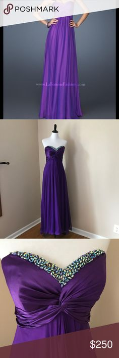 Beautiful La Femme Purple Strapless Prom Dress ✨ Gorgeous Purple Strapless La Femme Prom Dress with Beautiful Gemstone Detail. Size 8. In Like New condition! No noticeable imperfections! Originally cost $425 at a Boutique. The gemstone lining are a little loose and can easily be sewn tightly. The perfect prom dress! ✨✨✨✨✨✨✨ Hoping it finds a good new home to someone who can wear it this year to Prom! ✨✨✨✨✨✨✨ La Femme Dresses Prom