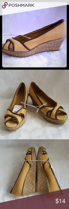 """NWT - Tan and Brown Wedge with Woven Heel New - caramel tan wedge open peep  toe shoe with chocolate brown piping trim. 2 1/2"""" woven wedge heel with about a 1"""" platform. Style is """" Wenda"""" by Merona.   New with tags. Slight scuff on outer right shoe near heel. I'm not sure how it even got there since these have never been worn. Smoke free and pet free home. Merona Shoes Wedges"""