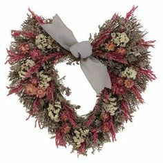 """Bring lush appeal to your decor with this lovely preserved wreath, crafted with caspia, pink sudan, white sinuata, and pink strawflower. Its heart silhouette and silver-hued ribbon add charming country style to your porch or sunroom.   Product: WreathConstruction Material: Caspia, sudan, sinuata, strawflower, satin ribbon, and twigsColor: Pink , white, and silverDimensions: 16"""" H x 16"""" W x 4"""" D"""