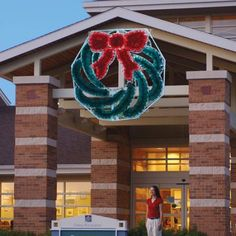 Garland Wreath LED Light Display 8 ft. H - Giant Garland Wreath perfect for commercial display. Professionally designed and built by hand using only the highest quality materialsm, including commercial-grade LED C7 lights and fade-resistant fine-cut garland for attractive daytime viewing.  $1,999.00