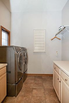 Main floor laundry with HE washer/dryer, drying racks and folding table  3847 Tessier Trail, Vadnais Heights, MN 55127  http://www.movingtominnesota.com/property-item/gorgeous-vadnais-heights-home/