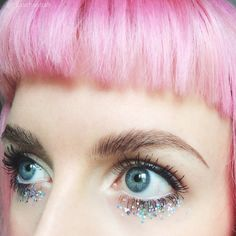 Girl with pastel pink hair and glitter makeup on eyes