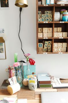 a little too cluttered, but I love the box shelves above the desk