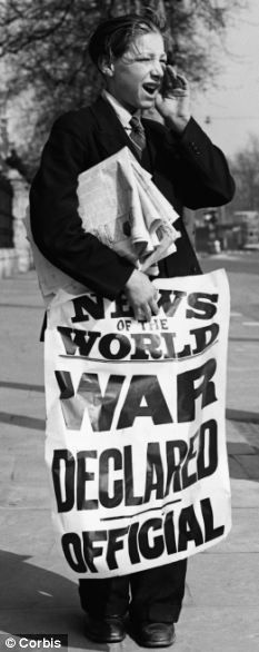 A paper boy breaks the news of the start of WWII on September 3, 1939.