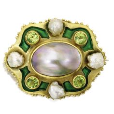 GOLD, MABÉ PEARL, FRESHWATER PEARL AND PERIDOT BROOCH, MARCUS & CO., EARLY 20TH CENTURY Set in the center with a mauve-colored mabé pearl measuring approximately 22.0 by 17.0 mm., framed by round peridots and freshwater pearls, accented by green champlevé enamel, signed Marcus & Co