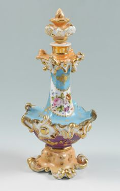 JACOB PETIT HAND PAINTED PORCELAIN PERFUME BOTTLE:  19th century, hand painted floral garland in reserves.  Jacob Petit blue makers mark on base, overall measures 9 1/4'' h. x 4 1/2''.