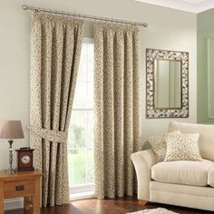 Embroidered with a pattern of leaves in a green colourway, these lined curtains feature a classic pencil pleat header and are available in a range of sizes....