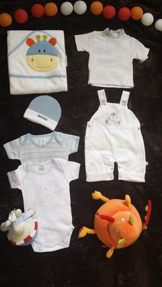 *** Sweet cupcake Baby Boy sets ****  Beautiful Boys Newborn Baby Outfit: Perfect present for a baby shower party. Mix of  bodysuits + shoes + socks + set: gloves, socks, hat, etc..   **** PLUS! a set of homemade, beautiful CUPCAKE TOPPERS GRATIS!!!!  ****  Ideal for a baby shower gift!!!