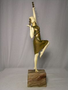 "D. H. Chiparus cold painted bronze and ivory of a woman performing a balancing act, titled ""Balancing Act"". Signed ""Chiparus"" in the base.Height of figure 14 3/4"". Overall height 18"". Reference Alberto Shayo Chiparus Master of art deco page 85.Circa 1920."