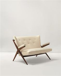 FRANCO ALBINI Rare 'Fiorenza' sofa, ca. 1946  Fabric, walnut. 34 x 52 x 33 1/2 in (86.4 x 132.1 x 85.1 cm) Manufactured by Cassina, Italy.