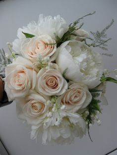 White peony, vendella rose and lily of the valley bouquet with asparagus fern