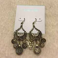 Dangle bronze earrings. Bronze dangle earrings with crystal embellishment. Never worn. Maurices Accessories