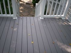 White vinyl deck rails and gray composite decking create a beautiful, soft color. Vinyl Deck Railing, Deck Railings, Cool Deck, Diy Deck, Deck Cost, Deck Building Plans, Laying Decking, Outdoor Decking, Wpc Decking