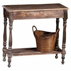 """Crafted of warmly weathered wood and showcasing turned legs, this rustic console table offers versatile design. Its open bottom shelf displays decor in your living room or stows outdoor accessories in the foyer.      Product: Console tableConstruction Material: WoodColor: Weathered greyFeatures:Turned legsOpen lower shelfDimensions: 30.5"""" H x 48"""" W x 18"""" D  Note: Basket pictured not included"""