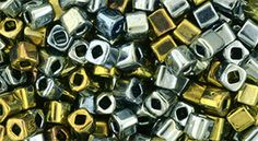 TC-03-721 TOHO - Cube 3mm : Galvanized Blue Gold