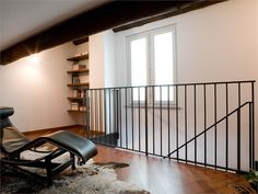 Simple black metal balustrade. Either too simple or would open the hallway up nicely - can't decide.
