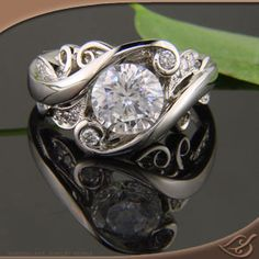 ooohh, pretty: Platinum Organic Wrap Style Mounting with Round Diamonds set throughout