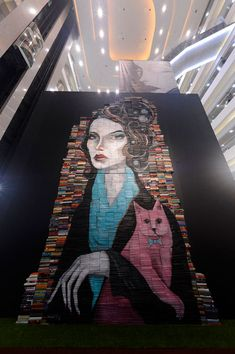 Mike Stilkey's Wonderfully Whimsical Book Paintings  by Emily Temple