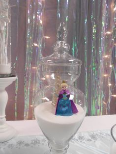 Use Apothecary jars as cute table displays for a Frozen party