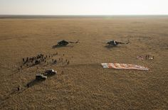 Expedition 40 Soyuz TMA-12M Landing  Ground support personnel are seen at the landing site after the Soyuz TMA-12M spacecraft landed with Expedition 40 Commander Steve Swanson of NASA, and Flight Engineers Alexander Skvortsov and Oleg Artemyev of the Russian Federal Space Agency (Roscosmos) near the town of Zhezkazgan, Kazakhstan on Thursday, Sept. 11, 2014. Swanson, Skvortsov and Artemyev returned to Earth after more than five months onboard the International...