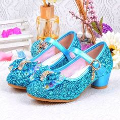 What little girl doesnt want to be a princess? These blue Frozen Princess Elsa inspired beautiful bling glitter sparkle girls shoes are perfect for any outing. The pearl bow and crystal embellishments add so much flair to this already gorgeous shoe. This shoe is perfect for flower girls. Perfect for
