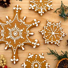 This gingerbread cookies look so deliciously beautiful I don't know whether to eat them or hang them in my window!