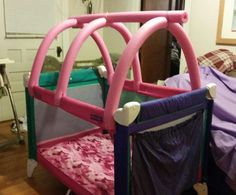 From Pack n play to toddler bed, using pool noodles and zip ties...