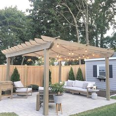 DIY pergola is seriously impressive! Plus, we love how she incorporated matching decor, such as the plant container and side table. Tip: adding twinkle lights to your outdoor space can be the cherry on top! 😍 Share your outdoor space with us using Diy Pergola, Outdoor Pergola, Diy Patio, Outdoor Decor, Pergola Kits, Pergola Lighting, Pergola Roof, Patio Ideas On A Budget, Curved Pergola