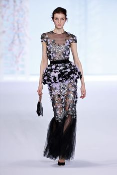 Ralph & Russo's Spring 2016 Haute Couture show was an ode to unabashed femininity, dazzling craftsmanship and jaw-dropping production. Eschewing the hefty, over-embellished and matronly style o...