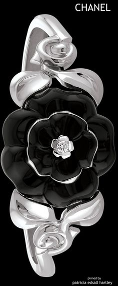 CHANEL~ Black Camellia Bracelet. The camellia is one of Chanel's iconic motifs.