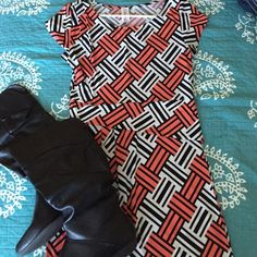 Mod-inspired dress This dress is just fun!! Mod-inspired print in white, coral, and black. Flattering asymmetrical waistband with a few subtle loose pleats. Dress goes to about mid-thigh on me (I'm 5'8.) purchased from a boutique. EUC worn twice- washed by hand and hung dry. Size tag is completely faded, but it is size large. Fits on the small size of large; would work for a medium. Purple Rain Dresses