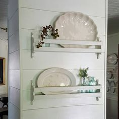 Small shelves on the wall for vintage platters