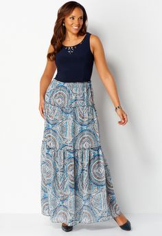 A simple stunner, this maxi dress mixes materials for totally trendy texture. The stretchy, solid top is splashed with sparkling rhinestones, and it falls into a silky-soft bottom with a medallion print and plenty of fresh, feminine tiers. #CBK #workfashion #fashion #maxidress