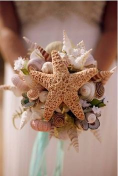 See stars at your beach wedding. Order shells and sea stars online or buy them at a crafts store to make a DIY wedding bouquet.