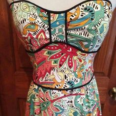 """Retro Nanette Lenore Bustier strapless dress EUC! Gorgeous dress with removable straps. 97% cotton / 3% spandex Lining: 94% polyester 6% Lycra Bust measures approx 31"""" Length 34""""  No flaws! In perfect condition! Nanette Lepore Dresses Strapless"""
