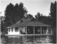 "1905 photo of a houseboat on Lake Washington    Great floating homes history from From MOHAI:  ""Houseboats have been popular in various parts of Seattle for many years. Plain and fancy summer houseboats showed up on Lake Washington soon after the opening of the Yesler cable car line in 1888. Both upper class and working class people lived in houseboats on Lake Union. There were speakeasy houseboats during Prohibition and working class houseboat dwellings on the Duwamish during the…"